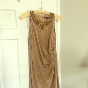 Glam it up in this gold dress by David Meister!